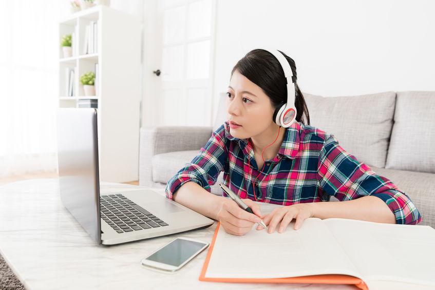 pretty beautiful female student wearing headset